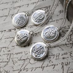 wax seal initial necklace from Etsy <3