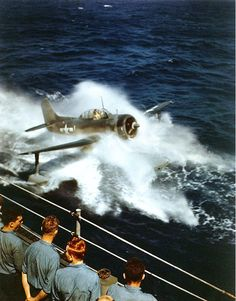 """historywars: """"One of the Alaska's Curtiss floatplanes taxiing up to the landing mat streamed alongside, to be picked up by the aircraft crane, off Iwo Jima, 6 Mar """" Ww2 Aircraft, Military Aircraft, Amphibious Aircraft, Military Weapons, Battle Of Iwo Jima, Flying Boat, Ww2 Planes, Military History, World War Two"""