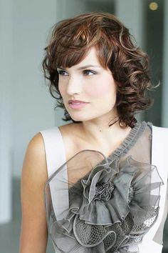 15 Cute Hairstyles for Short Curly Hair: #13. Curly Short Hair Girl