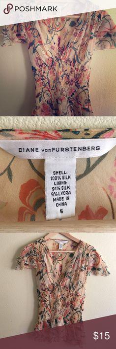 Diane Von Furstenberg silk peplum top Worn once so it's in nice shape. 100% silk. Comes with matching cami liner. Lovely! Diane von Furstenberg Tops Blouses