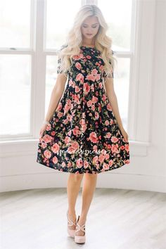This adorable, light weight, floral dress will keep you cool and cute all summer long! Navy dress features a pink floral print, babydoll elastic waist, short sleeves and cute front pockets.