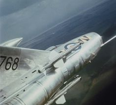 An English Electric Lightning of No 74 Squadron at RAF Leuchars, Fife, banking sharply to port. Note the Red Top air-to-air missiles mounted on fuselage pylons and the tip of the starboard over-wing long range fuel tank. Air Force Aircraft, Navy Aircraft, Aviation Image, Aviation Art, Military Jets, Military Aircraft, Top Air, Military Pictures, Jet Plane