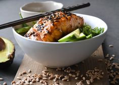 Japanese rice bowl with teriyaki marinated salmon, wakame & edamame beans