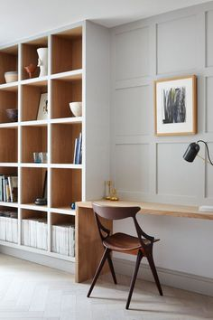 Part bookshelf, part built-in study, grays rule in this modern and cozy home office. Note the two-toned effect of the shelving and how it extends a hint of warmth against the paint.