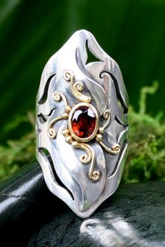 """""""Xena"""" One of a kind Garnet Ring with 22k Gold and Sterling Silver Made with love!  www.melissacaron.com"""