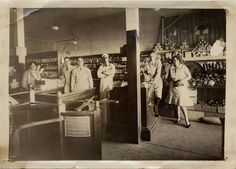 Interior of a Piggly Wiggly Market, 1929. Pictured left to right are two female employees and customers, Gilbert Bramble, George Winfield, Gene Perkins, and Nick Raseli. San Fernando Valley History Digital Library.