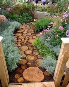 Make your house your Beautiful. Create a path in your garden even if it leads to nowhere, it can become a focal point to build off of. The use of these tree stump pavers tie in nicely with the existing decking.