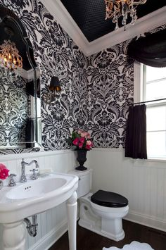 Love this bathroom!!! i'm not too huge on the wall paper pattern but i do like the wall paper idea