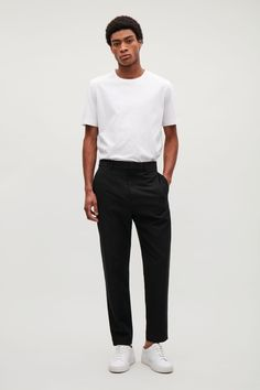 Smart trousers, these are tailored from a soft cotton-lyocell blend and cut to a tapered fit. They are intentionally designed with minimal hardware, side-seam pockets and invisible hem and concealed double hook and eye fastening with zip fly.   Complete the look with the  grandad-collar shirt with hidden pocket.