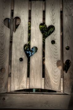 Hearts in the Fence |Pinned from PinTo for iPad| Much like the gate to my back gardens, only mine has one very large heart cut into the body of the gate.                                                                                                                                                                                 More