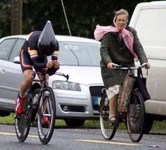 Obviously he's flying along, but you could also interpret this that he's being passed by the little old lady.