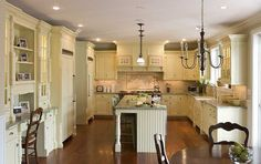 How black appliances look in a cream colored kitchen. Traditional ...