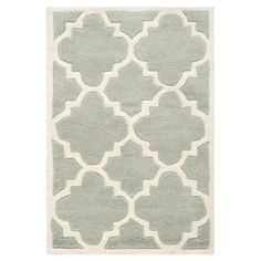 Anchor your dining set or living room seating group in style with this hand-tufted wool rug, showcasing a quatrefoil motif in ivory and grey.