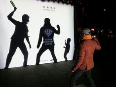 "This interactive social ad on a sidewalk in South Korea. It shows the silhouettes of an adult man and a child that he's threatening with a bottle.And there's an empty space between the two big enough for the passersby to step up.  The text on the top of the ad says: ""Child abuse, you can prevent it."" When a passer-by decides to step into the scene, a superhero-like logo appears on his or her shadow with an emergency number (112) and this message: ""Report to become a hero for children."""