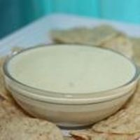 Queso Blanco with a gentle bite: 1 lb block White American Cheese, cut into 1-inch cubes, the juice from a small original Rotel,  2/3 cup whole milk  1/2 cup water, stir over med heat until the cheese is melted and smooth. For more spice add the chilies too or reserve them for another dish.