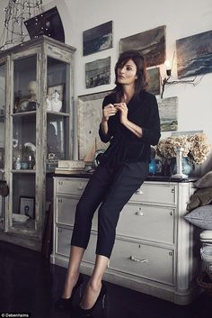 The Danish supermodel poses in an array of chic outfits including jumpsuits, cigarette pants, dresses and even lingerie in muted shades of plum, indigo and black.