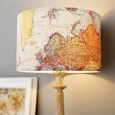 Handmade vintage map lampshade. Before affixing the map to the shade, use a pushpin to puncture small holes in the places you have traveled to. You will have an illuminated personal travels map!