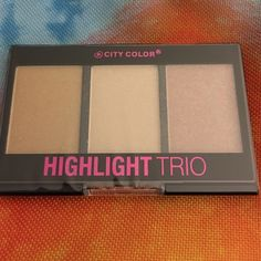 City Color Contour Highlight Trio Full Sz. NIP City Color highlight trio for light to medium skin. Use to contour the face or even as eyeshadow. Powder. Full size 3 X 0.083 grams each. New in package, still wrapped. Has a bit of shimmer and would be a great light bronzer. City Color Makeup Bronzer