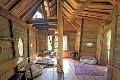 Rustic Wooden Cabin Design With Purple Floral Rug On Laminate Floor Paired With Hole On Wooden Wall Design