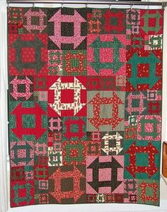 Yet another Christmas quilt that I love!  Love the churn dash block.  Might have to make this pattern again!