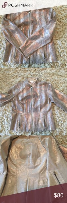 Chico's crocodile print leather jacket This authentic leather jacket has a crocodile print outside with pink , silver and gold it says it's a size one, I would say it's between a 8-10 It's also reversible although the inside which is a beige crocodile print does have a couple of spots, which could probably be easily addressed. Shows no sign of wear on the outside, just the couple of spots on the inside, beautiful jacket in almost mint condition. Make an offer, bundle and save Chico's Jackets…