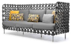 The Cabaret furniture set for living room includes unique sofa, easy armchairs, coffee tables and small tables, made of fabric tubes woven over a steel frames.