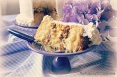 Cake. Vanilla Cake. Caramel Filling. Pecans. Coconut. Buttercream. Fiesta. Lilac.