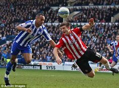 Chris O'Grady beats Sheffield United's Harry Maguire to the ball