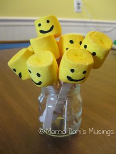 mix yellow food coloring with water and paint the marshmallows. When dry, draw on the faces with food markers.