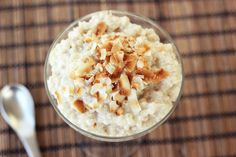 Creamy, rich Coconut Tapioca Pudding with Toasted Coconut Chips. A creamy, coconutty, tapioca treat... YUM! The beautiful golden brown, toasted coconut on top brings a nice contrasting crispy texture to this super creamy decadent desser
