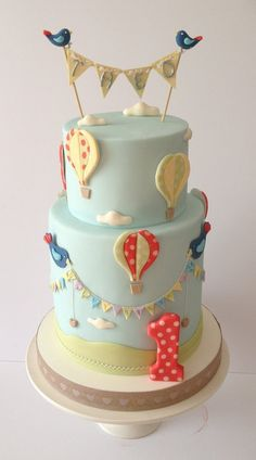 For a little boys first birthday. The party was a shabby chic theme. The cake designer tried to choose colors and images that were pretty bu...