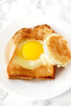 Challah egg in a hole is a great recipe to make in the morning and a great use for leftover challah!   #thetasteofkosher #challah #challahbread #leftovers #egginahole #eggs #breakfast #toast Breakfast Toast, Breakfast Recipes, Breakfast Ideas, Kosher Recipes, Bread Recipes, Dairy Free Recipes Easy, Egg In A Hole, Egg Toast, Challah