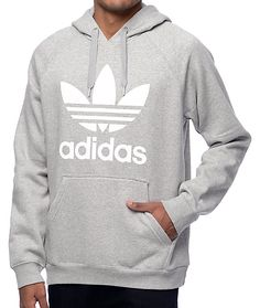 Rock the original adidas steez with the Originals Trefoil heather grey hoodie from adidas. The fleece lined grey colorway features an adjustable drawstring hood, front kangaroo pouch pocket and a black screen printed trefoil logo on the chest. Perfect for