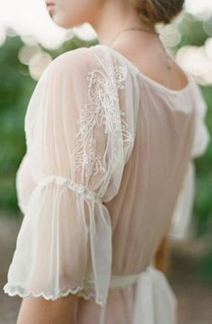 Delicate loveliness.- I'm loving embroidered mesh sleeves. It's such a nice twist as opposed to the typical lace backed shirt.
