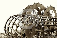 This is a closeup image of equipment used for rice agriculture the barrel wheels are put onto a tractor and this allows the tractor to cultivate in deep water and mud Deep Water, Agriculture, Mud, Tractors, Barrel, Wheels, Rice, Image, Barrel Roll