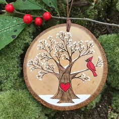 Snowy, winter tree with red cardinal and heart. Custom made, personalized wood slice ornament. Handmade by Forage Workshop - Snowy, winter tree with red cardinal and heart. Custom made, personalized wood slice ornament. Handmade by Forage Workshop Wood Slice Crafts, Wood Burning Crafts, Wood Burning Patterns, Wood Burning Art, Diy Christmas Gifts, Rustic Christmas, Christmas Projects, Holiday Crafts, Christmas Decorations