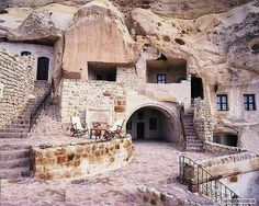 Homes in Iran, carved out of solid rock, built 700 years ago.