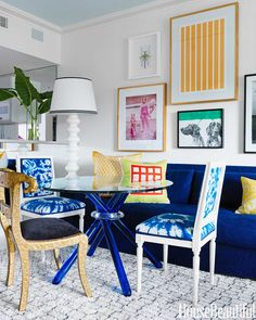 This Modern Miami Pad is a Colorful Must-See // gallery wall, velvet sofa, Louis-XVI chairs