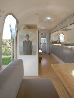 Design Ideas, A Contemporary Airstream Renovation With A Man In Suit Painting On The Wall And Also A Grey Cabinets With A Microwave On It An...