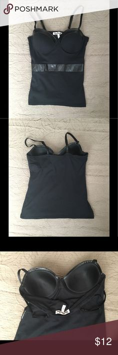 NWOT tank top with built in bra. Tag says medium but fits more like small to extra small. Adjustable straps , faux leather detailing on top and right below bust. Bra and top for the price of one! True Freedom Tops Tank Tops