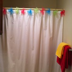Tulle bows- cheap and fun way to dress up a shower curtain for girls bathroom.