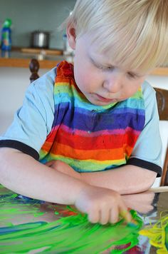 Finger Painting on Foil! Super easy, slippery fun!