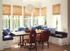 Love everything about this - the blues, under bench storage, window treatments, hanging pendant!