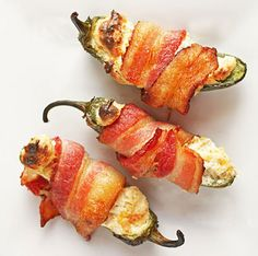 Turn up the heat with these bacon-wrapped jalapeños, stuffed with cream cheese, salsa verde, and cheddar cheese.