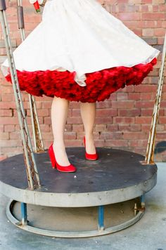 short wedding dress with a red petticoat // photo by FeatherandStone.com.au