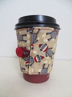 Fabric Coffee Cozy Sock Monkey Design by ThreadBasket on Etsy