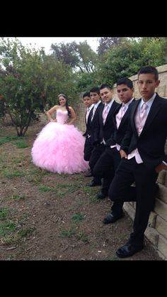 The Chambelanes are wearing pink vests to match the Quince girl's dress!