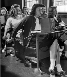 sms before mobile phoneby Nina Leen - I wonder if this even happens anymore. Can teachers take your phone and read your text log aloud? School must be weird now.