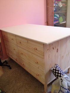 """DIY Cutting Table for sewing/craft room- 2 Ikea Tarva Tables pushed together with a plywood top cut to 39"""" X 64"""". The 12 drawers serve as great storage space for notions and tools."""