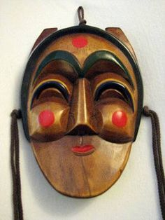 Korean traditional mask of the character Bune, the Young Woman //   Kallie Szczepanski